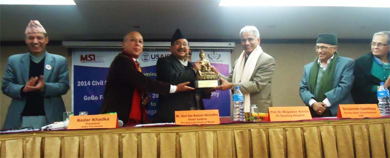 Rt. Hon'ble Chief Justice Kalyan Shrestha handingover the 'GoGo Foundation Award' to Prof Dr Bhagawan Koirala on 11 Feb. 2016